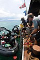 US Navy 110618-N-VF350-050 Navy Divers assigned to Mobile Diving and Salvage Unit (MDSU) 1 unload a rigid-hull inflatable boat after a series of un.jpg