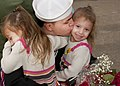 US Navy 111115-N-OV802-304 Damage Controlman Fireman Dylan Graf hugs his daughters after returning from deployment aboard the guided-missile frigat.jpg