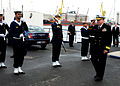 US Navy 120202-N-ON468-173 U.S. Navy Rear Admiral renderes honors.jpg