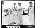Unidentified RAN Lieutenant Commander(?) and RAN Commander Thomas J M Hilken, at the public celebrations for the return to port of HMAS SYDNEY (II), February 10th 1941 (3294217812).jpg