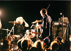 Vocalist and guitarist Justin Trosper and drummer Sara Lund performing with Unwound