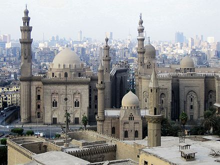 Mosque-Madrassa of Sultan Hassan (left) along with the later Al-Rifa'i Mosque (right) and two Ottoman mosques (foreground) - Cairo View from the citadel.JPG