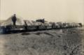 Vista de carros de ferrocarril con carga de piedras, con trabajores sobre ellos, Chile, ca. 1913.png