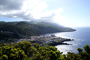Velas - Partial vista of the town of Velas, showing the southern coast and village of Urzelina in the distance, São Jorge