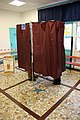 Voting booths with legs french presidential election Macron Le Pen.JPG