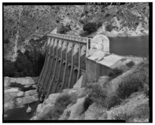 WEST END OF DAM, LOOKING SOUTHEAST, SHOWING DOWNSTREAM FACE OF SPILLWAY. - Little Rock Creek Dam, Little Rock Creek, Littlerock, Los Angeles County, CA HAER CAL,19-LITRO.V,1-29.tif