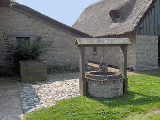 Walraversijde - Well at the reconstructed archeological site of Walraversijde ; ca. 1465