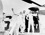 Waving Apollo 8 Astronauts Leaving Recovery Helicopter (5135053748).jpg