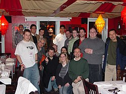 alt=Happy Wikipedians standing around a restaurant table