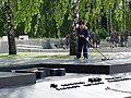 Woman Cleaning Monument - Khatyn National Memorial Complex - Near Minsk - Belarus - 03 (27581546795).jpg