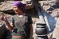 Woman brewing raksi (Nepali whisky) (4515010811).jpg