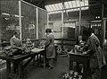 Women inspecting motor engine parts (15273576169).jpg
