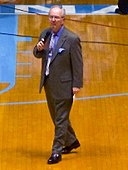Woody Durham walking to center court in Dean Smith Center color corrected closeup.jpg