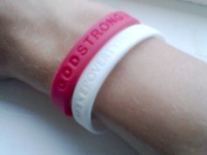 "Gel bracelet - Two wristbands; the Make Poverty History white ""awareness bracelet"" and a ""GODSTRONG"" band"