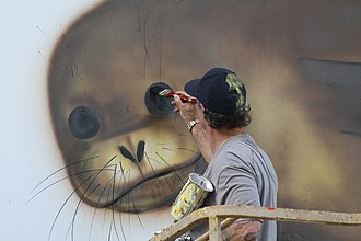 Robert Wyland - Wyland painting a mural on a former military barracks now part of the Midway Atoll National Wildlife Refuge