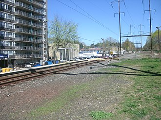 Wynnefield Avenue station - Facing Bala-bound on the Wynnefield Avenue station platform. The right-of-way for the second track is quite visible near the fence in the distance.