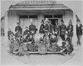 """""""Brig. Gen. Frank Wheaton, U.S. Army (standing center with white plume in hat), with officers and members of their famil - NARA - 530877.tif"""