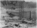 """Stewart Mountain spillway. View looking downstream along right wall showing progress of concreting and backfilling."" - NARA - 294631.tif"