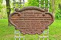 Церква святого Георгія з села Андруші. Табличка з церкви про повторне заснування села.jpg