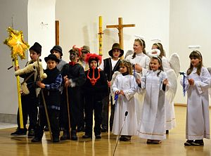 Star singers - Star boys and angels singing carols in church during Christmas and Epiphany in Sanok, Poland 2013