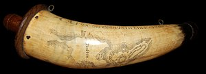 "Powder flask - British soldier's powder horn, 1775, engraved with a map of Boston, Massachusetts and ""A Pox on Rebels in ther Crymes""."