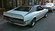 Shows a 1970 AMC Javelin featuring optional full black vinyl covered roof