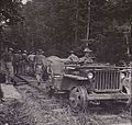 2-16 FIELD COMPANY, ROYAL AUSTRALIAN ENGINEERS, TRAVELLING ON A JEEP WHICH THEY CONVERTED FOR USE ON THE RAILWAY LINE.JPG