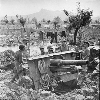 1st Sussex Artillery Volunteers - 25-pounder and crew in a waterlogged position across the Rubicon, October 1944.