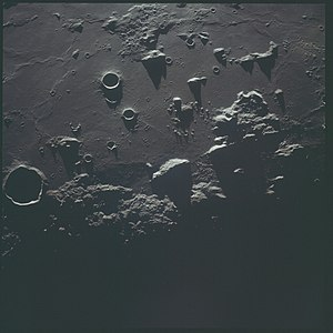 Gambart (crater) - View of the terminator also from Apollo 12, with Gambart at left and Turner left of center.  Apollo 14 landing site is in shadow at right (unmarked).