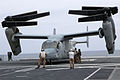 A U.S. Marine Corps MV-22B Osprey tiltrotor aircraft attached to Marine Medium Tiltrotor Squadron (VMM) 161 is raised from the hull of the Japan Maritime Self-Defense Force helicopter destroyer JDS Hyuga (DDG 130614-M-BZ222-021.jpg