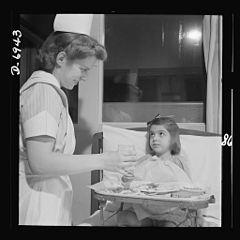 A convalescing youngster gets lunch 8b07711v.jpg