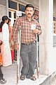 A differently abled voter showing his voter identity card after casting his vote at the polling booth in D.S.A. Stadium, during the 5th and final phase of General Election-2009, in Nainital, Uttarakhand on May 13, 2009.jpg
