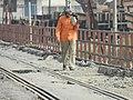A gangman checks the track over Kachhla bridge - Flickr - Dr. Santulan Mahanta.jpg