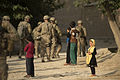 A girl in the town of Saka near Bagram Airfield, Afghanistan, watches as U.S. Airmen with the 455th Expeditionary Security Forces Group perform security duties June 13, 2013, during a road construction project 130613-F-YL744-021.jpg