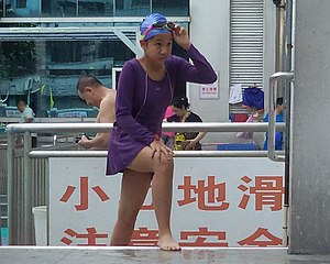 A girl wearing siamesed body-skin swimsuit in YXQMFC.jpg
