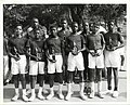 A group of boys hold basketball trophies (12461951975).jpg