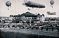 A large air-ship, aeroplane and hot-air balloons fly over a Wellcome V0040863.jpg