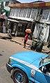 A paw-paw seller hawking in Ketu, Lagos, Nigeria.jpg