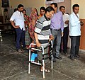 A physically handicapped voter arrives to cast his vote, at a polling booth during the 5th Phase of General Elections-2014, in Bangalore, Karnataka on April 17, 2014.jpg