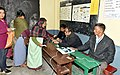A polling official administering indelible ink to a voter, at a polling booth, during the Meghalaya Assembly Election, in Shillong on February 27, 2018.jpg