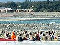 A study group by the Ganga at Muni ki Reti near Rishikesh.jpg