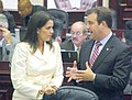 Adam Hasner and Anitere Flores confer on the House floor.jpg