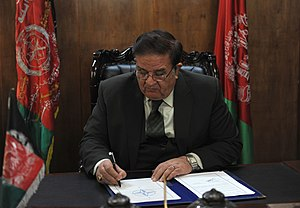 NATO Training Mission-Afghanistan - Afghan Defense Minister Abdul Rahim Wardak signing a NATO treaty in 2009.