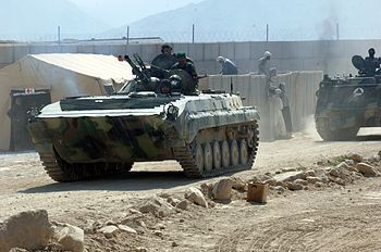 Afghan National Army soldiers depart in armore...