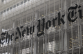 Alain Robert ascend of New York Times Building - 14 - NYT building sign.png