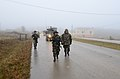 Albanian soldiers conduct a convoy patrol during a military adviser team (MAT) and police adviser team (PAT) training exercise at the Hohenfels Training Area, a part of the Joint Multinational Readiness Center 131213-A-LO967-002.jpg