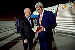 Ambassador Marc Sievers Shows Secretary Kerry a Bound Copy of his Schedule at the Muscat International Airport (22798779938).jpg