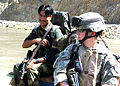 American and Afghan military police visit a remote village.jpg
