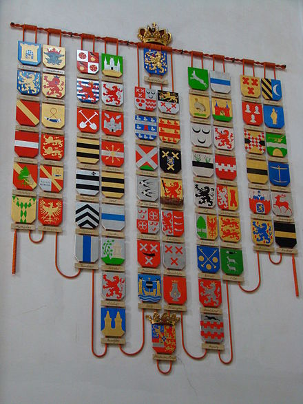 Coats of arms corresponding to the titles borne by various Dutch monarchs, displayed at Nieuwe Kerk in Amsterdam Amsterdam wapenbord.JPG