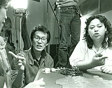 "Amy Hill interprets Wayne Wang's film direction on shooting a scene in ""Dim Sum- A Little Bit of Heart"".jpg"